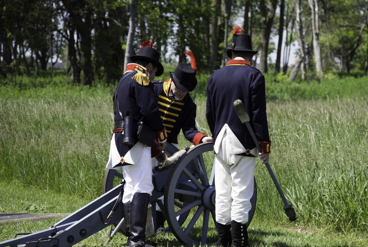 Reenactors tending to a cannon