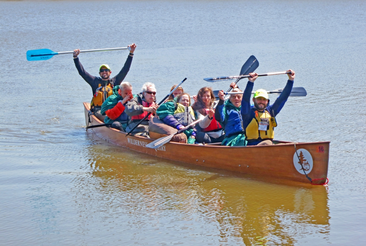 Group of adults happily paddling at Indiana Dunes National Lakeshore