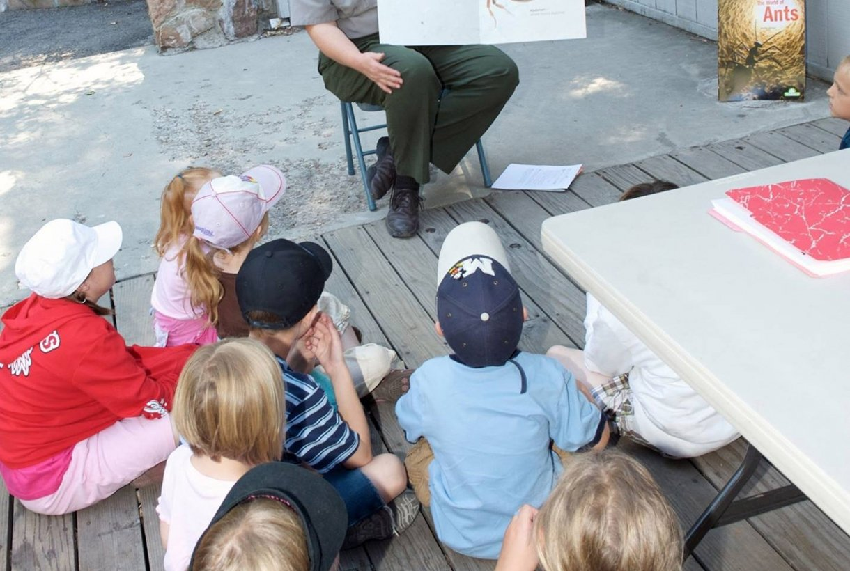 Ranger reading to group of kids