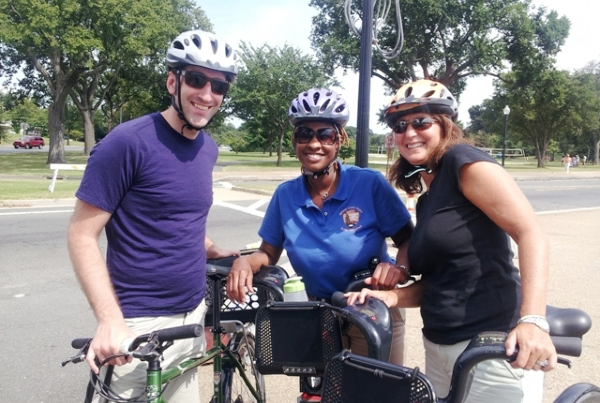 Michael Alvino, a National Park Foundation Transportation Scholar at National Mall and Memorial Parks in Washington, DC, enjoys a bike ride tour through the park with a National Park Service employee and a park visitor