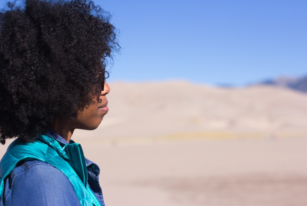 Profile of African American person looking out onto Great Sand Dunes