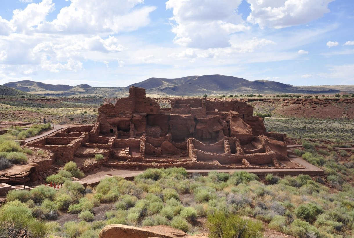 Image of Wupatki National Monument red, stone ruins in arid desert landscape