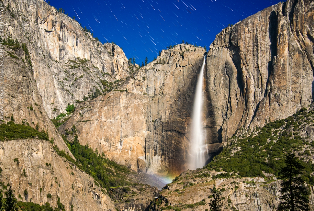 Photograph of Yosemite shot by Mason Cummings with bright, sunny blue sky and sharp rocky mountains