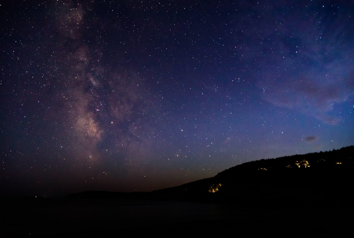 Dark sky and Milky Way over Sand Beach at Acadia National Park in Maine