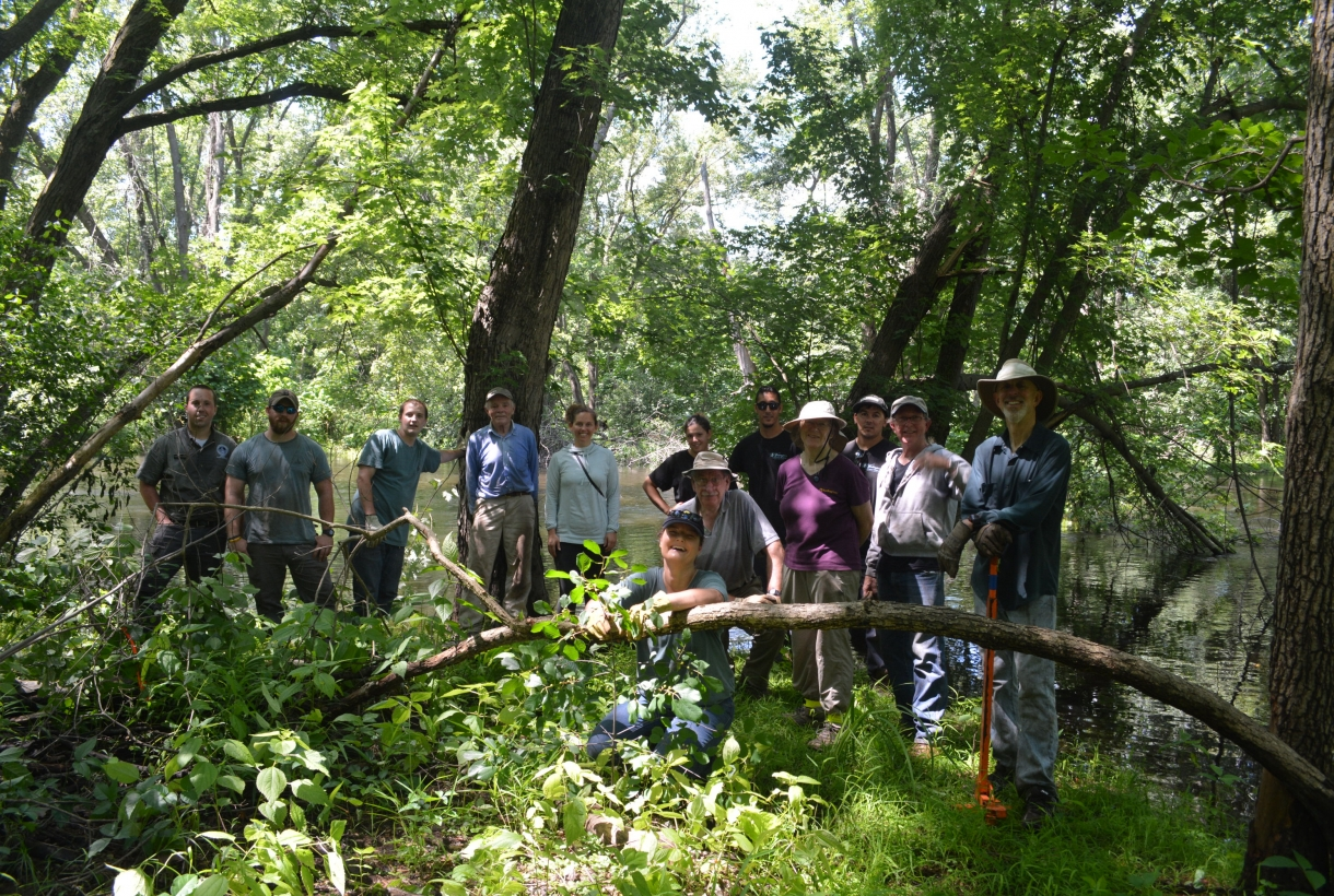 Volunteer group posing at Assabet River