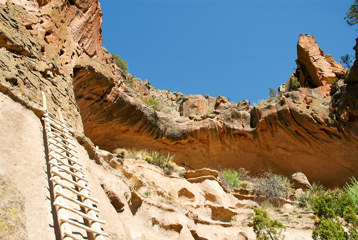 Upward view of a ladder leading to a cliff dwelling