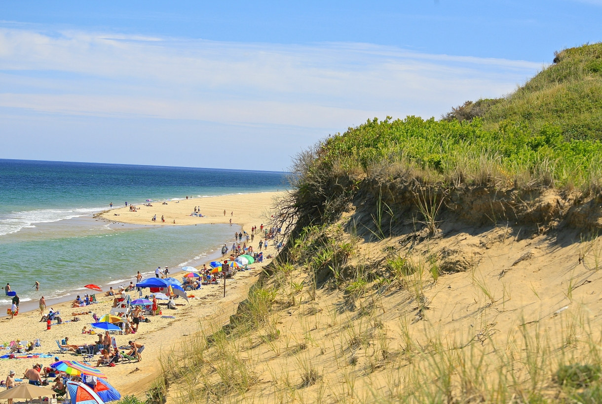 A crowd on a sandy Marconi Beach at Cape Cod National Seashore