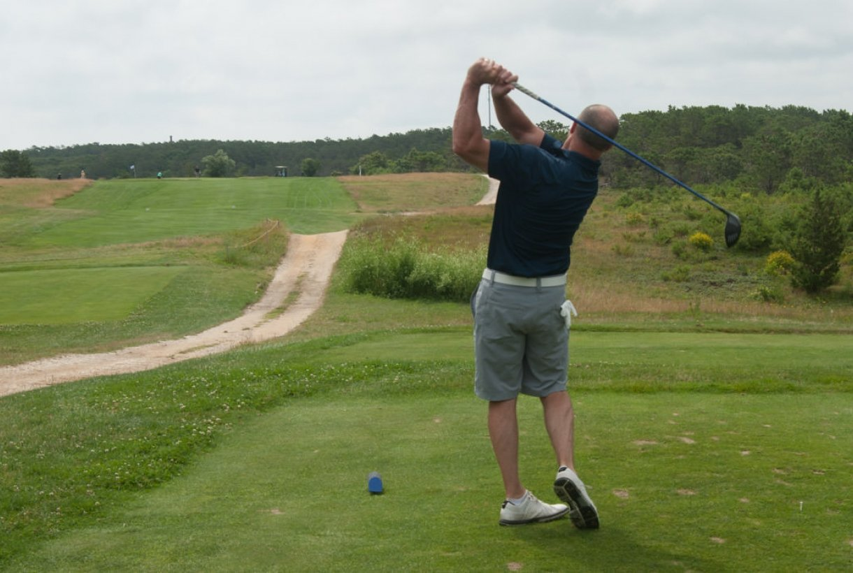 A man golfing at Cape Cod National Seashore