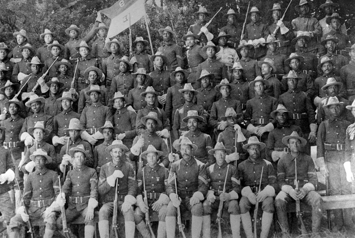 Soldiers sitting in rows for picture