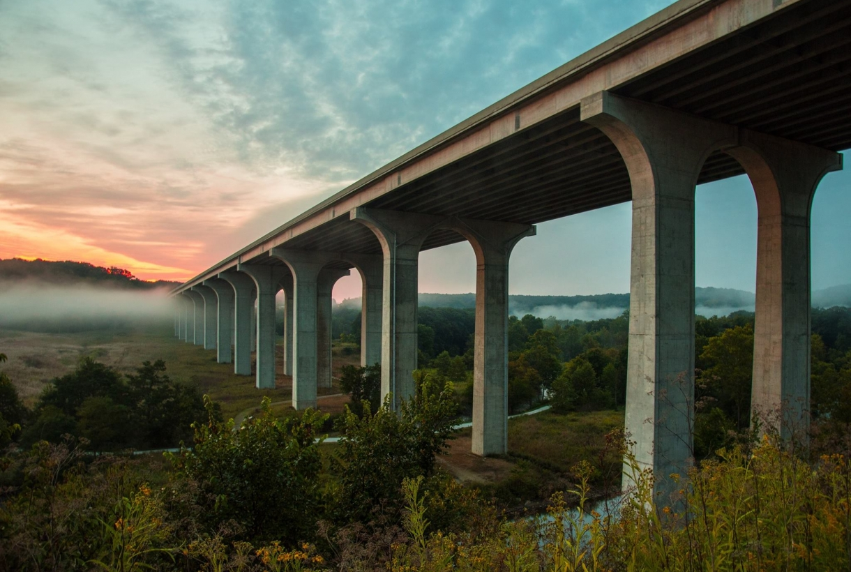 Big concrete bridge over foggy valley at Cuyahoga Valley National Park