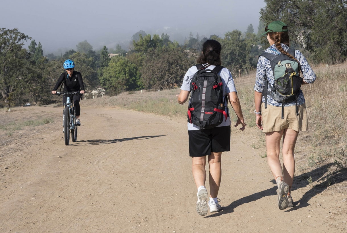 People hiking and biking in a National Park