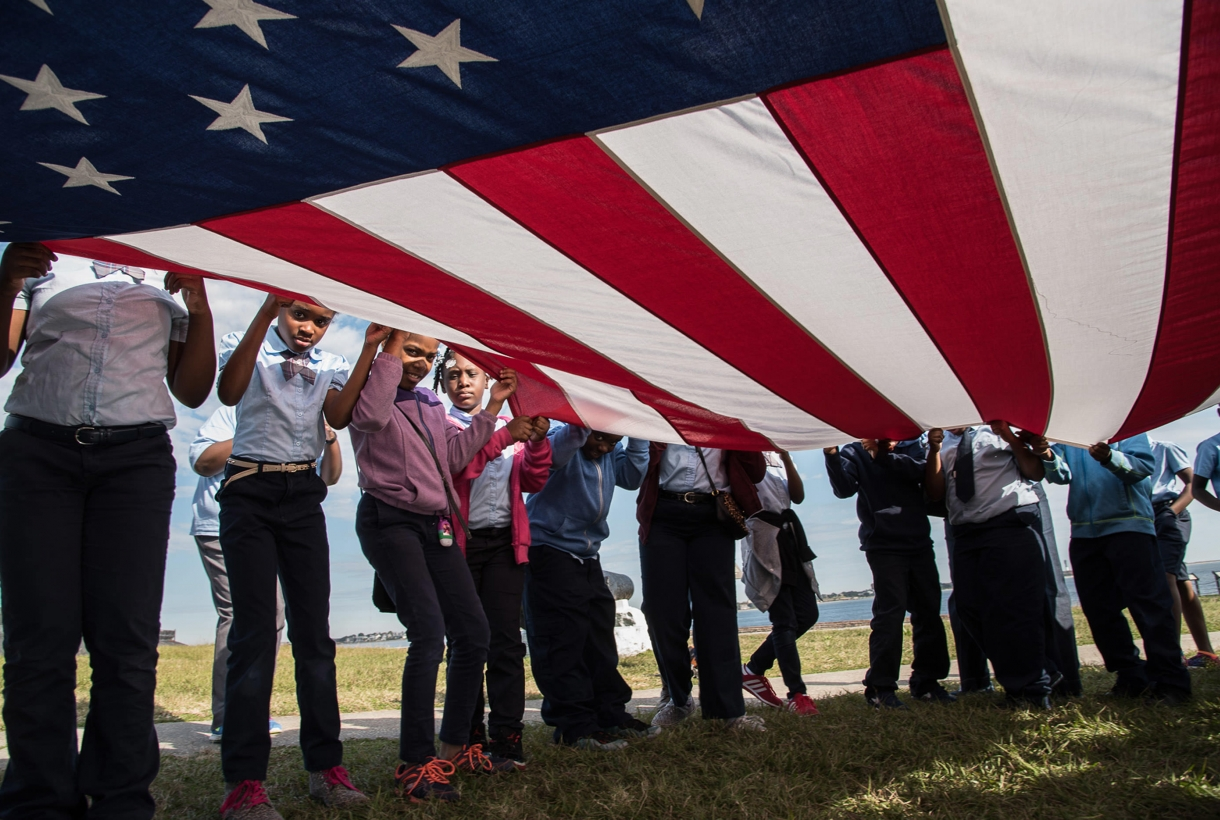 African American Kids holding an american flag