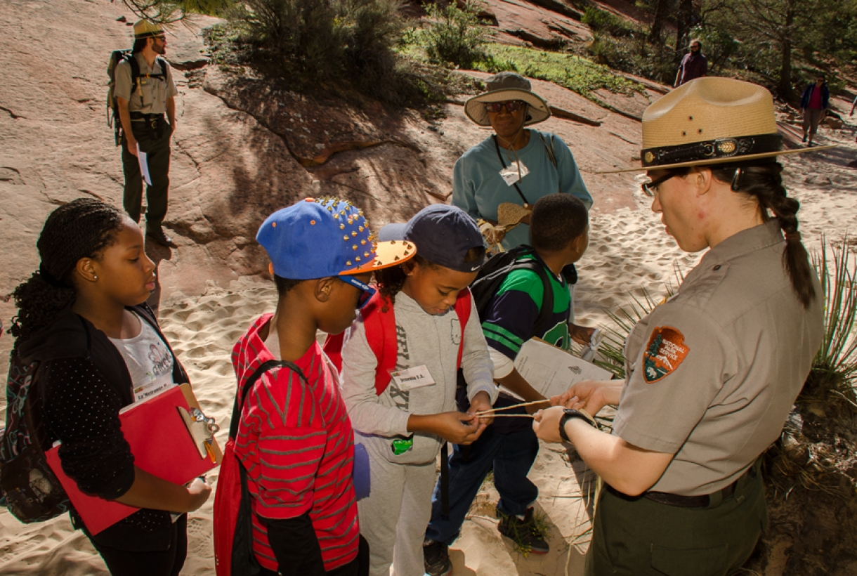 NPS Ranger teaching young students in the park