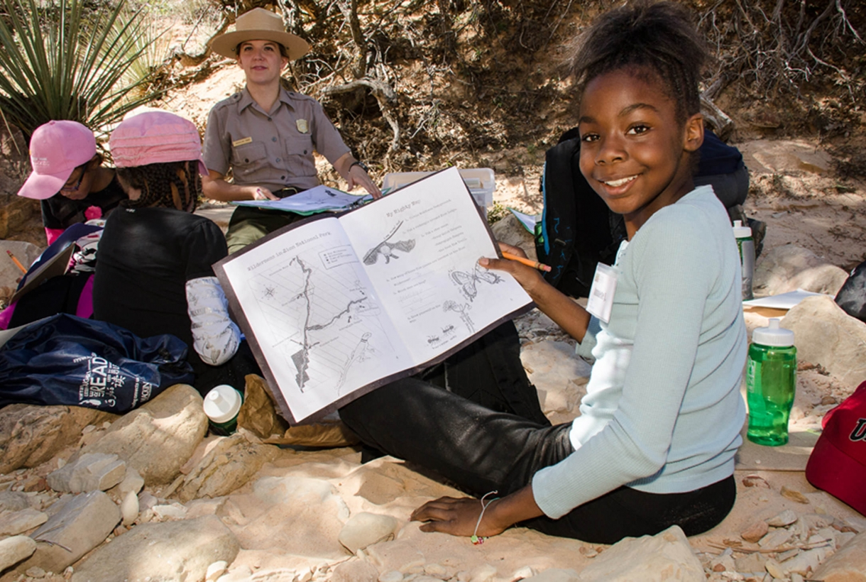Student sketching her wilderness trail findings