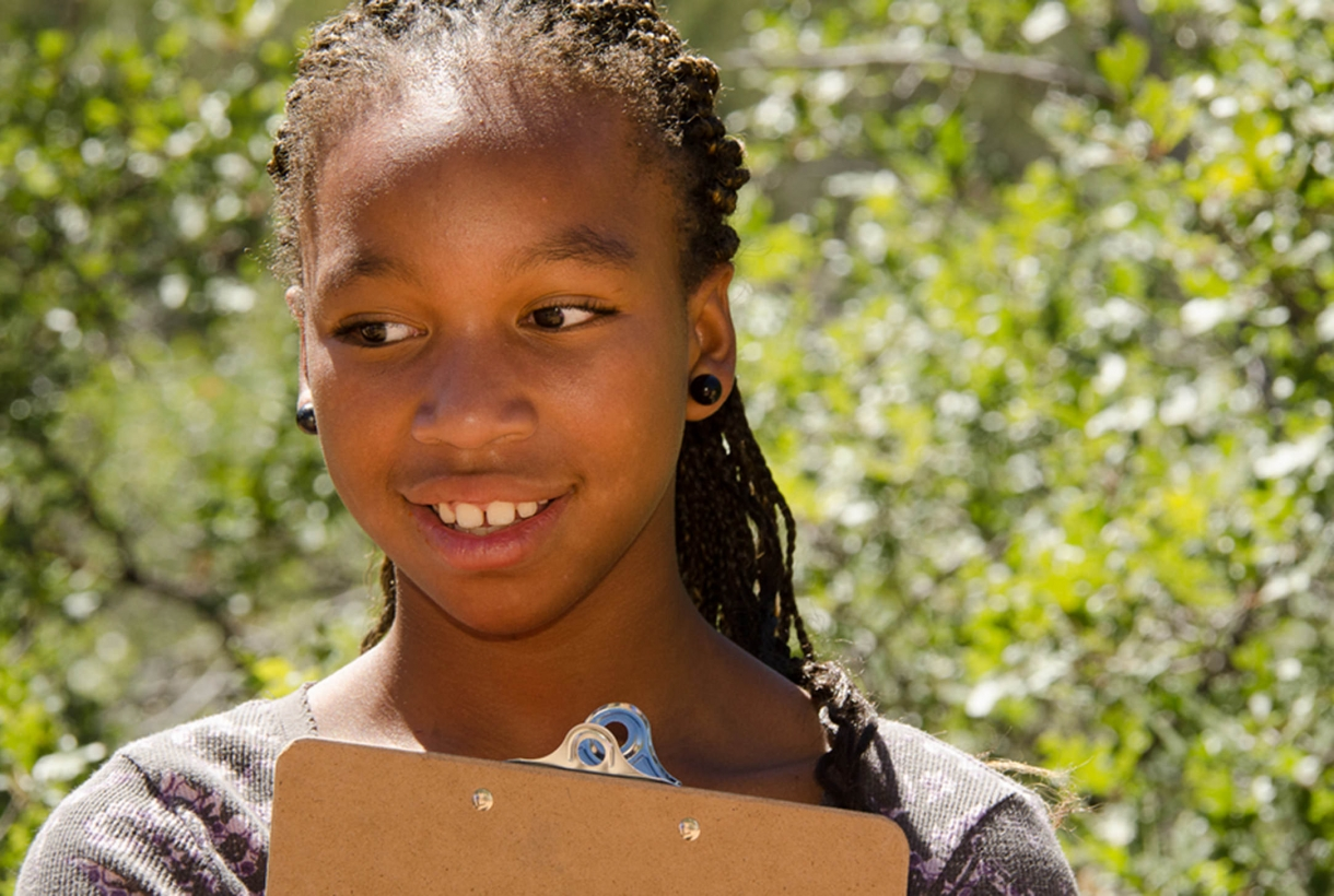 Girl taking part in an NPF program at a National Park