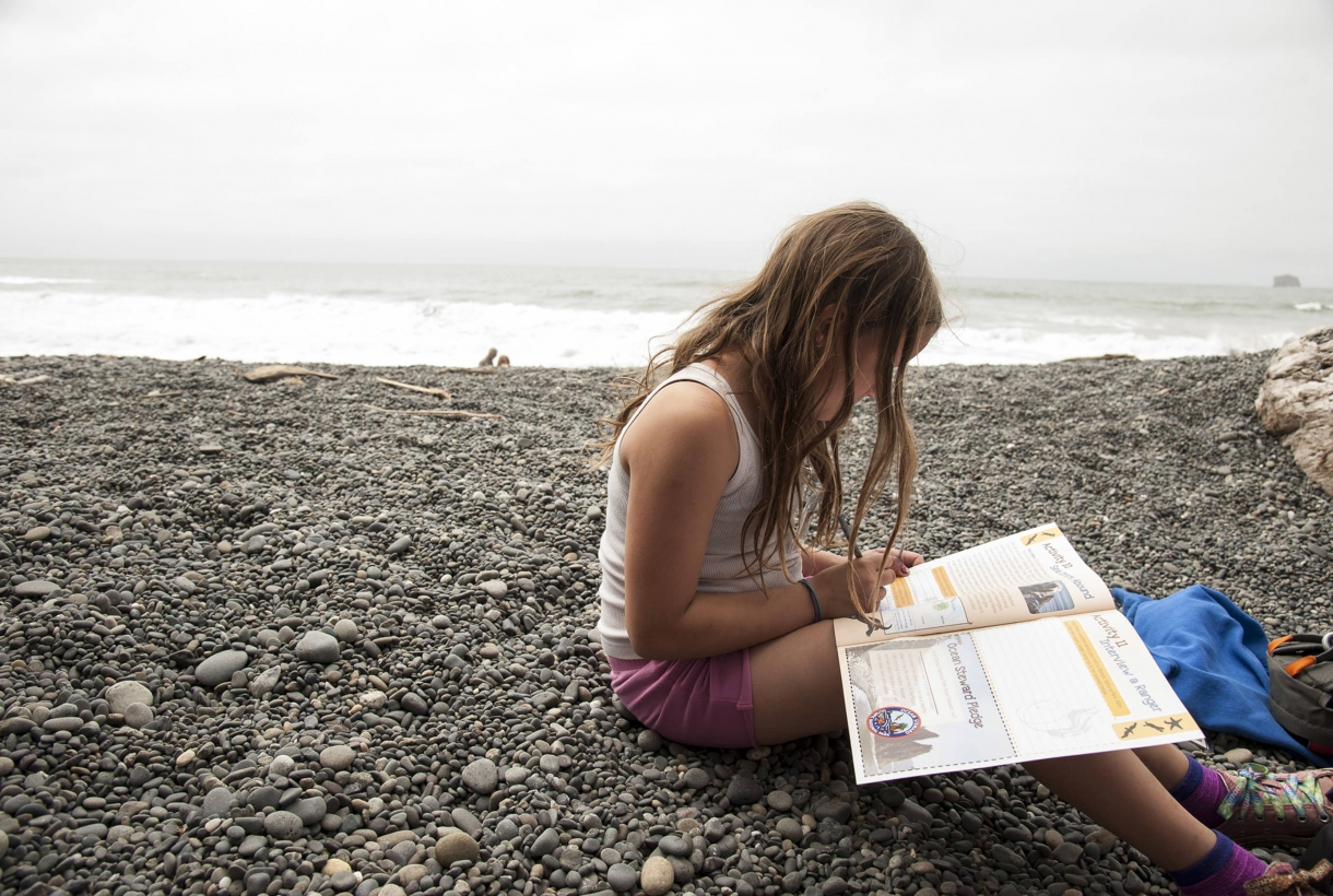 Girl reading on the beach