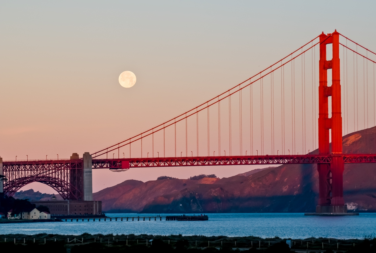 Golden Gate Bridge and the moon during the golden hour