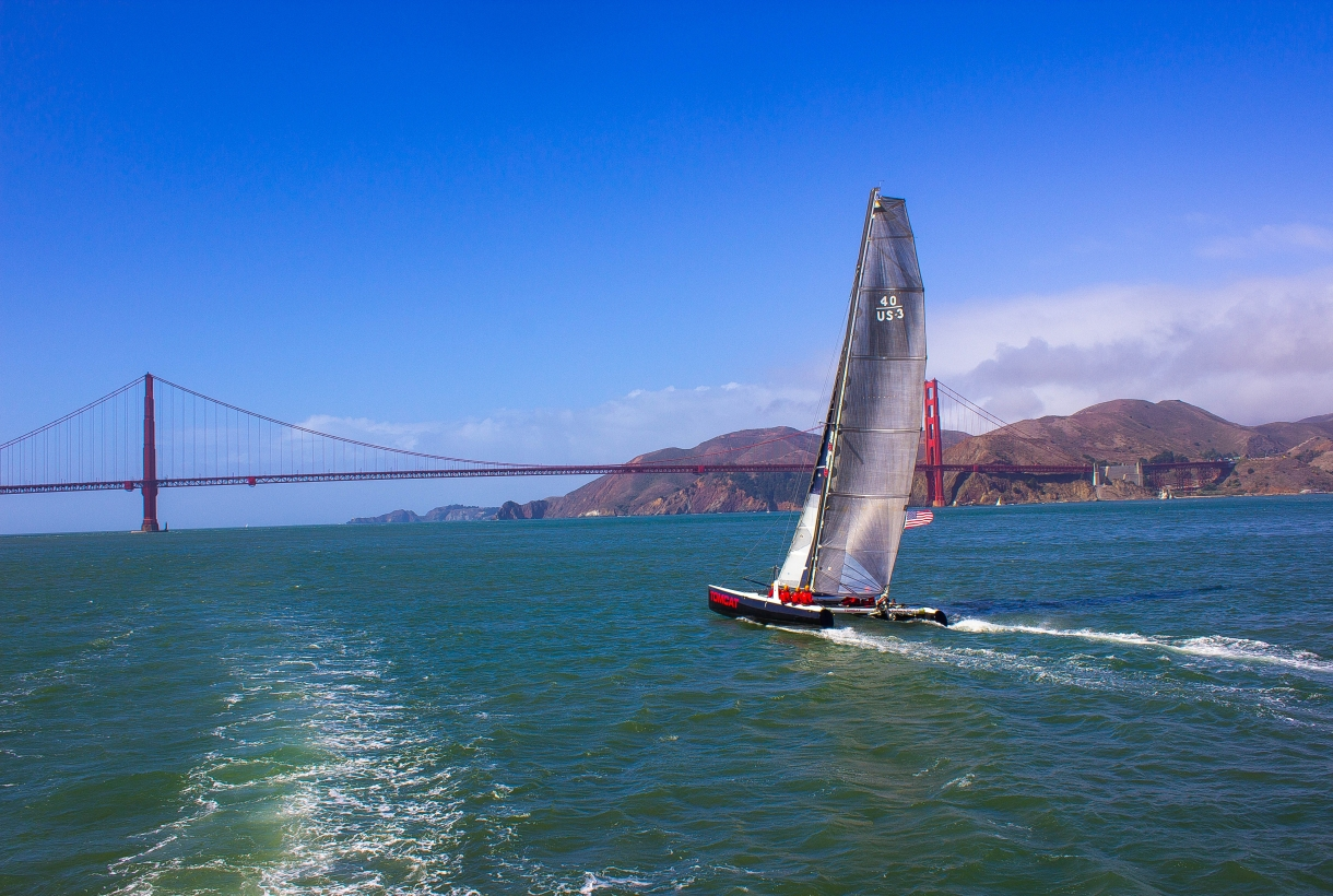 Sailing along open waters under a clear blue sky in Golden Gate National Recreation Area