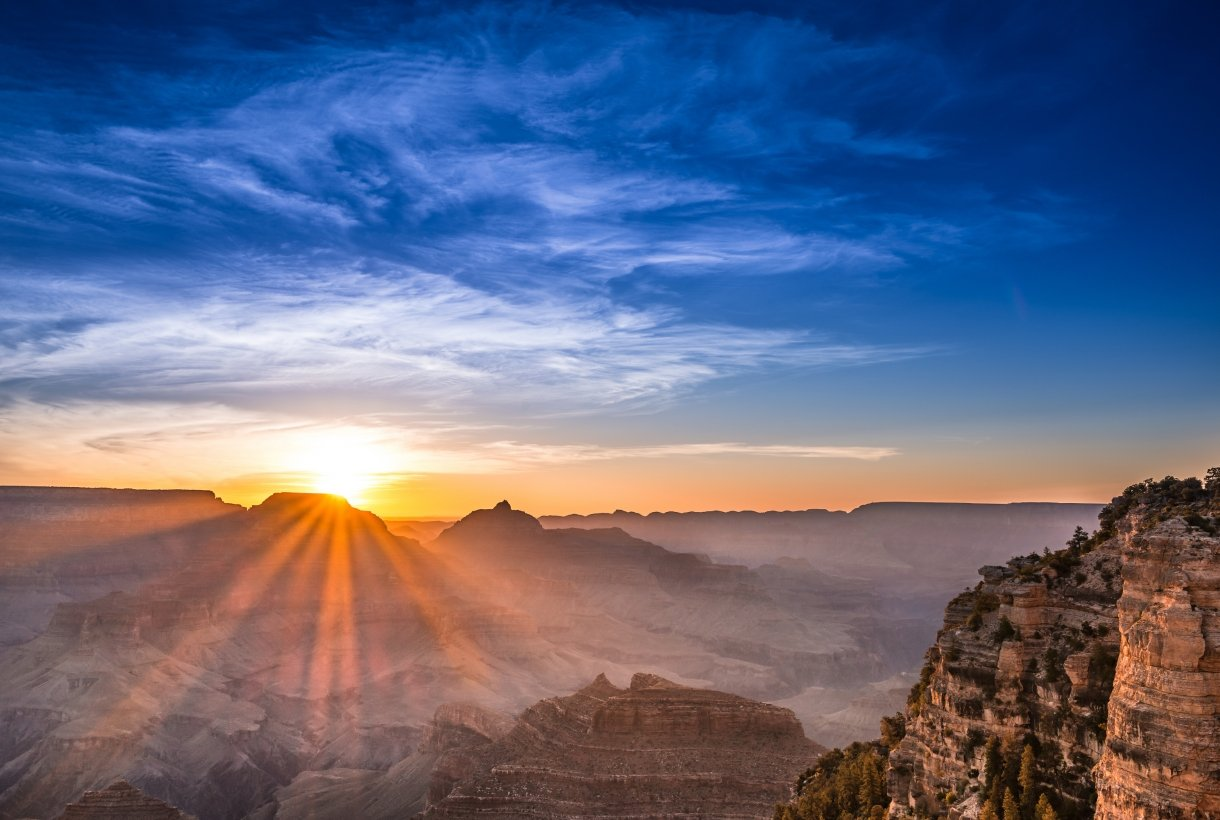 The sun just above the rim of the canyon at Grand Canyon National Park