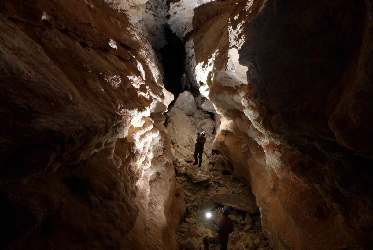 A person standing in an underground cave at Jewel Cave National Monument