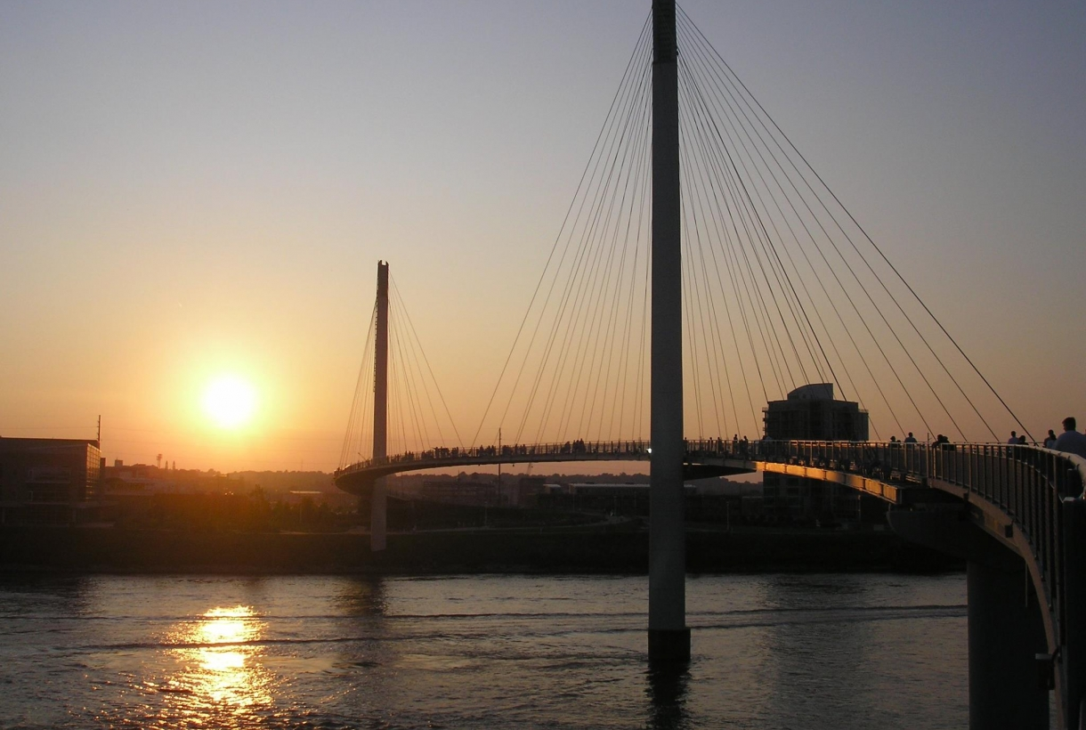 The sun setting behind the Bob Kerrey Pedestrian Bridge along the Lewis and Clark National Historic Trail