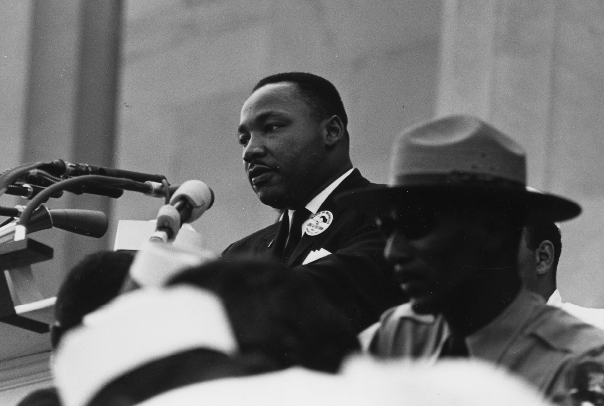 Dr. Martin Luther King Jr. at the podium on the steps of the Lincoln Memorial during the March on Washington for Jobs and Freedom
