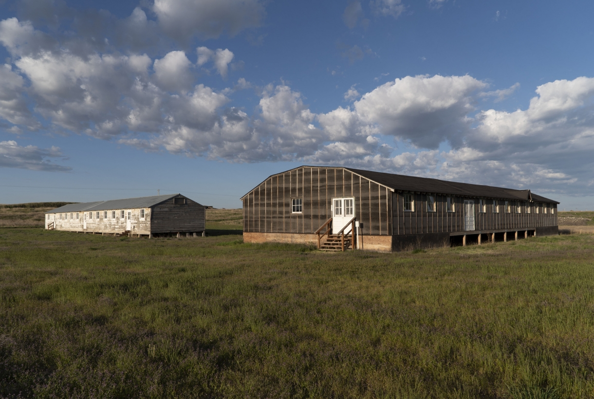 barrack and mess hall with grass and sky