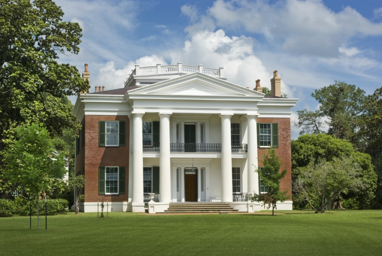Front of a brick and white columned Antebellum-style building at Natchez National Historic Park