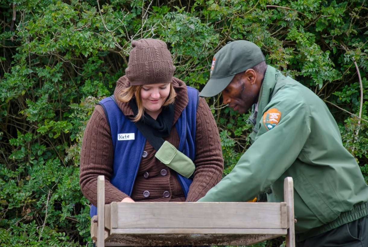 Ranger and volunteer conducting field work in a national park