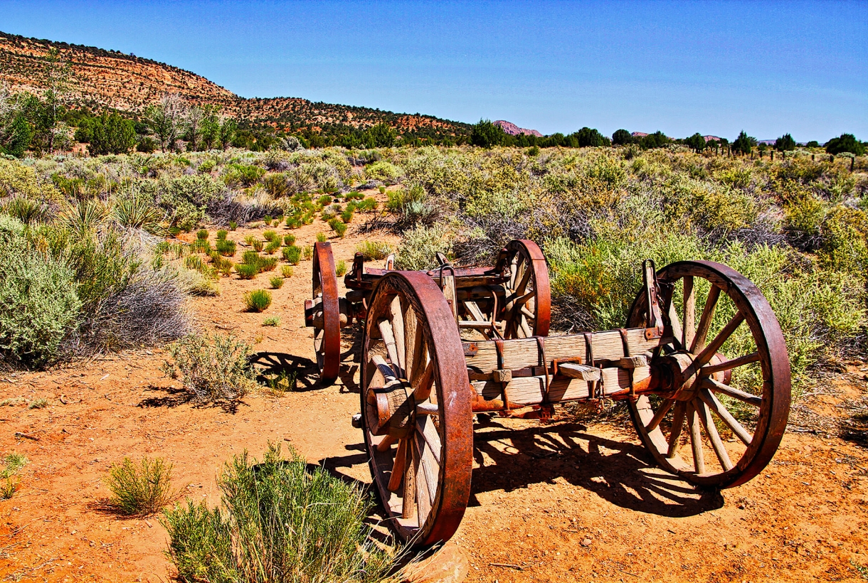 a wagon sits in a craggly landscape