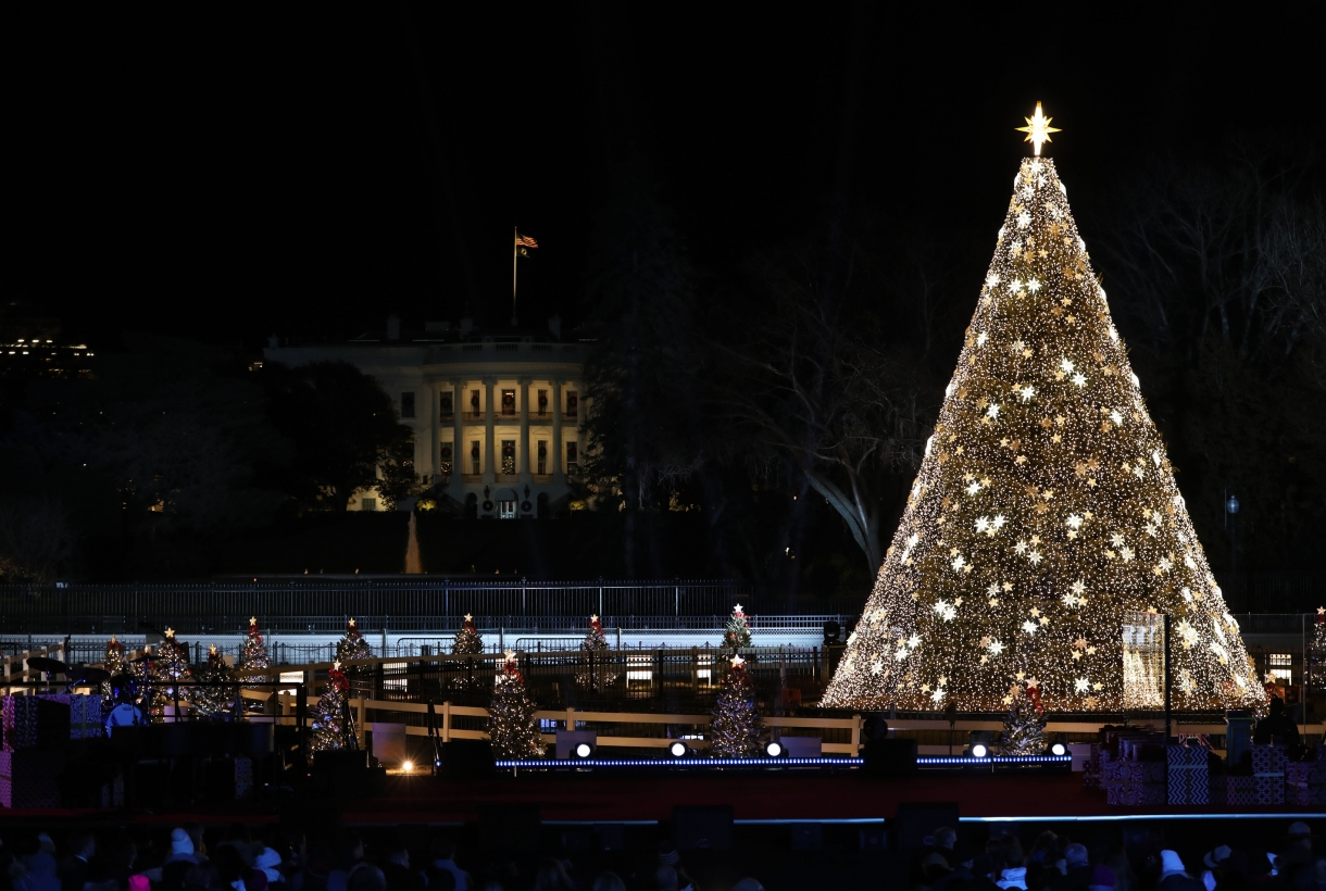2019's National Christmas Tree Lighting Ceremony in President's Park - the White House can be seen in the distance