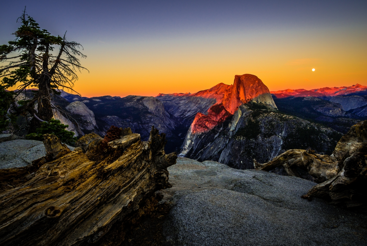 Colorful sunset on Half Dome at Yosemite National Park