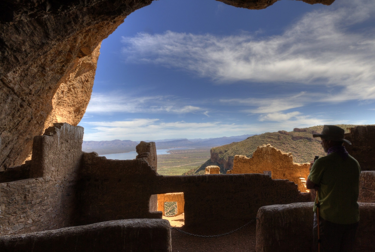 A view from the upper ruins of the Arizona landscape beneath cloudy blue skies at Tonto National Monument.