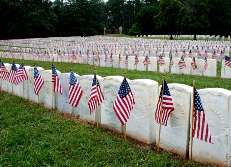 Flags adorn tombstones at Andersonville National Historic Site