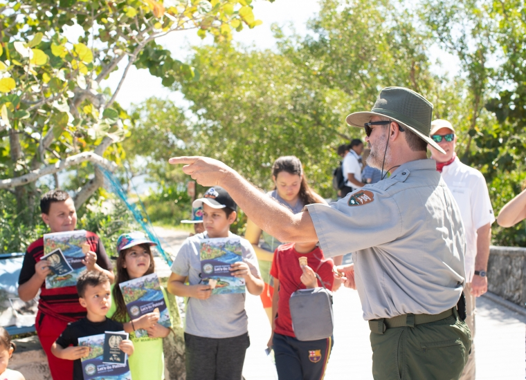 A ranger instructs a group of Junior Ranger Anglers in training