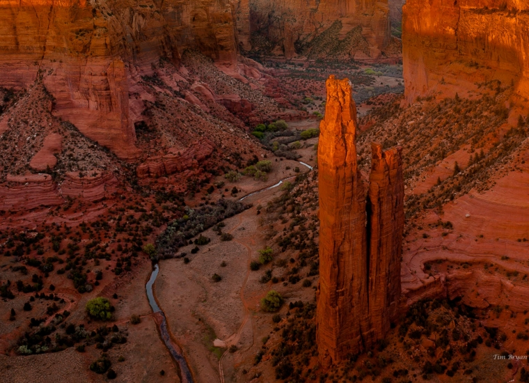 Sunset view of the towering Spider Rock and surrounding landscape at Canyon de Chelly National Monument