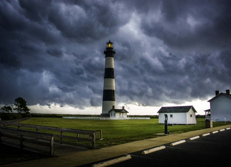 Stormy clouds over the black and white lighthouse on Bodie Island at Cape Hatteras National Seashore