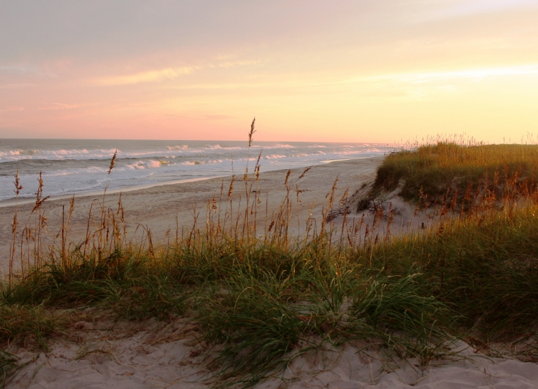 Sunset on a grassy sandy beach at Cape Hatteras National Seashore