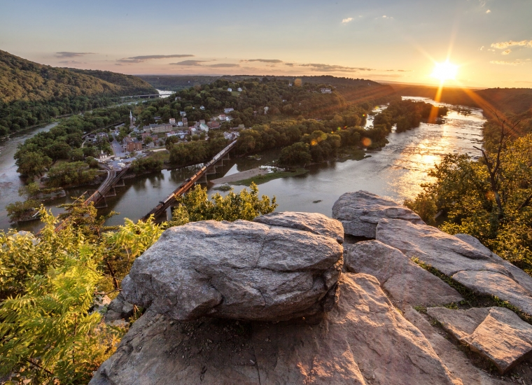 View from above of Harpers Ferry National Historical Park, nestled between two rivers as the sun rises