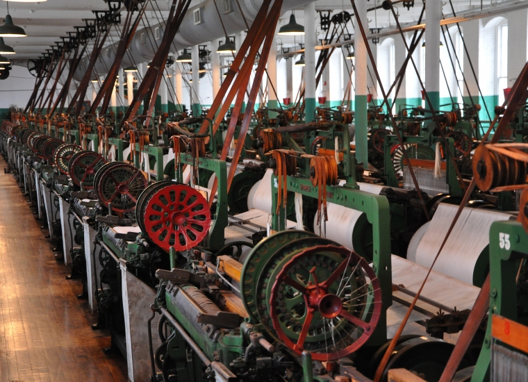 Cotton mill weave room, with green and red mill machines
