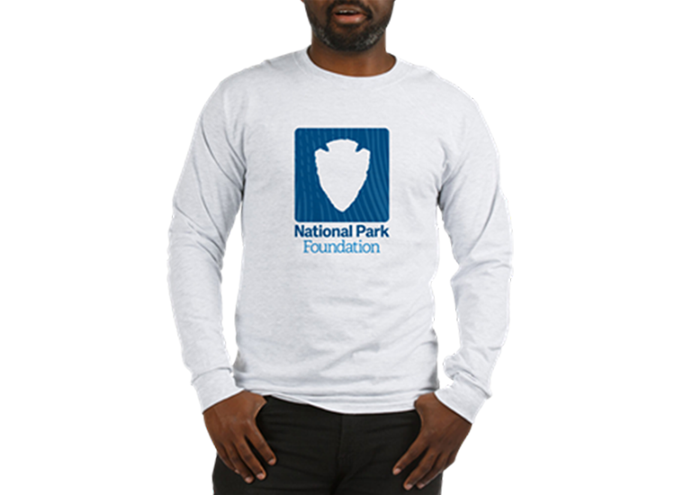 Man wearing white long sleeved tee with blue NPF logo on front