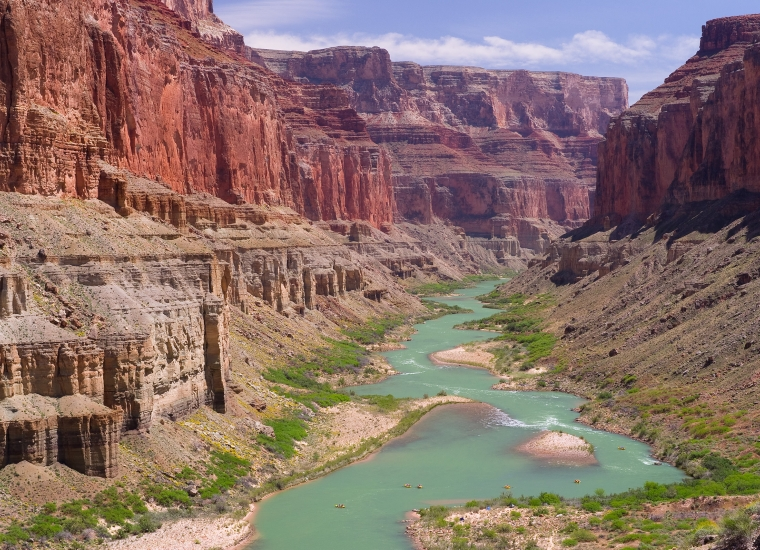 The pastel green Colorado River winding through the red sandstone canyons at Grand Canyon National Park