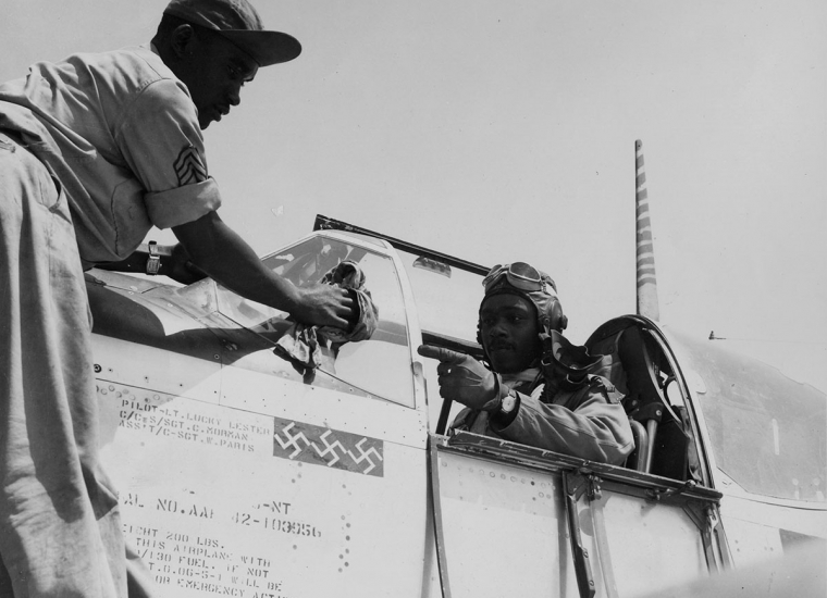 Tuskegee Airmen pilot preparing plane for war
