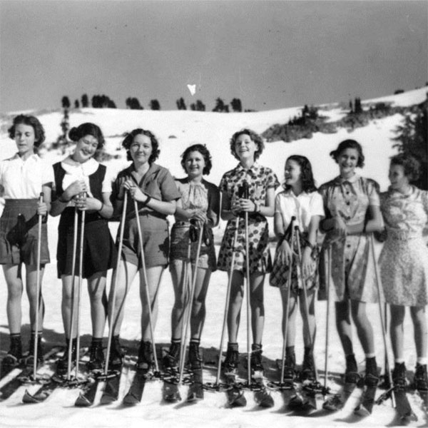 Group of girls wearing skies on a slope