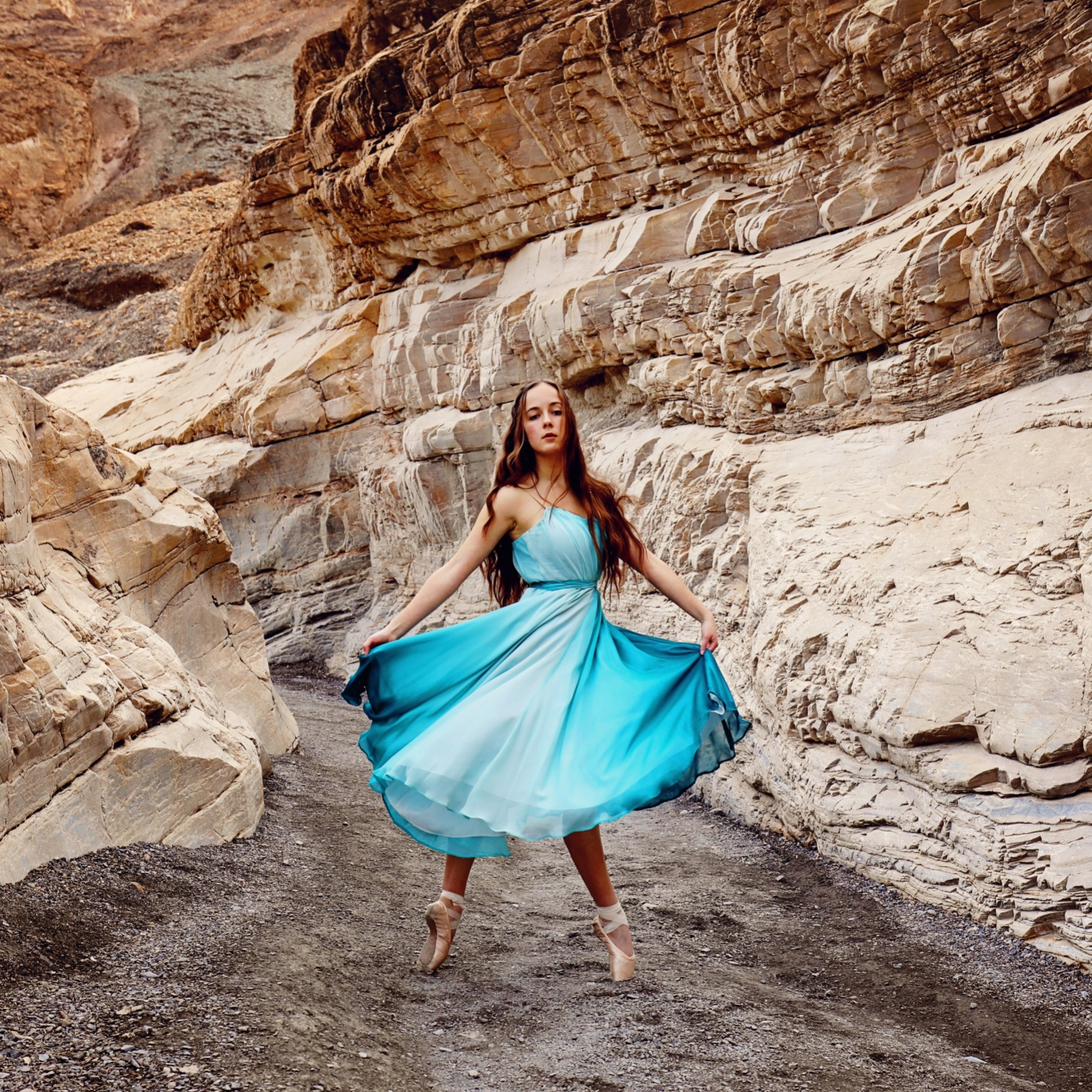 Dancer on pointe in turquoise chiffon dress by Christina Morgan Cree in Golden Canyon Death Valley photo by Bari Lee