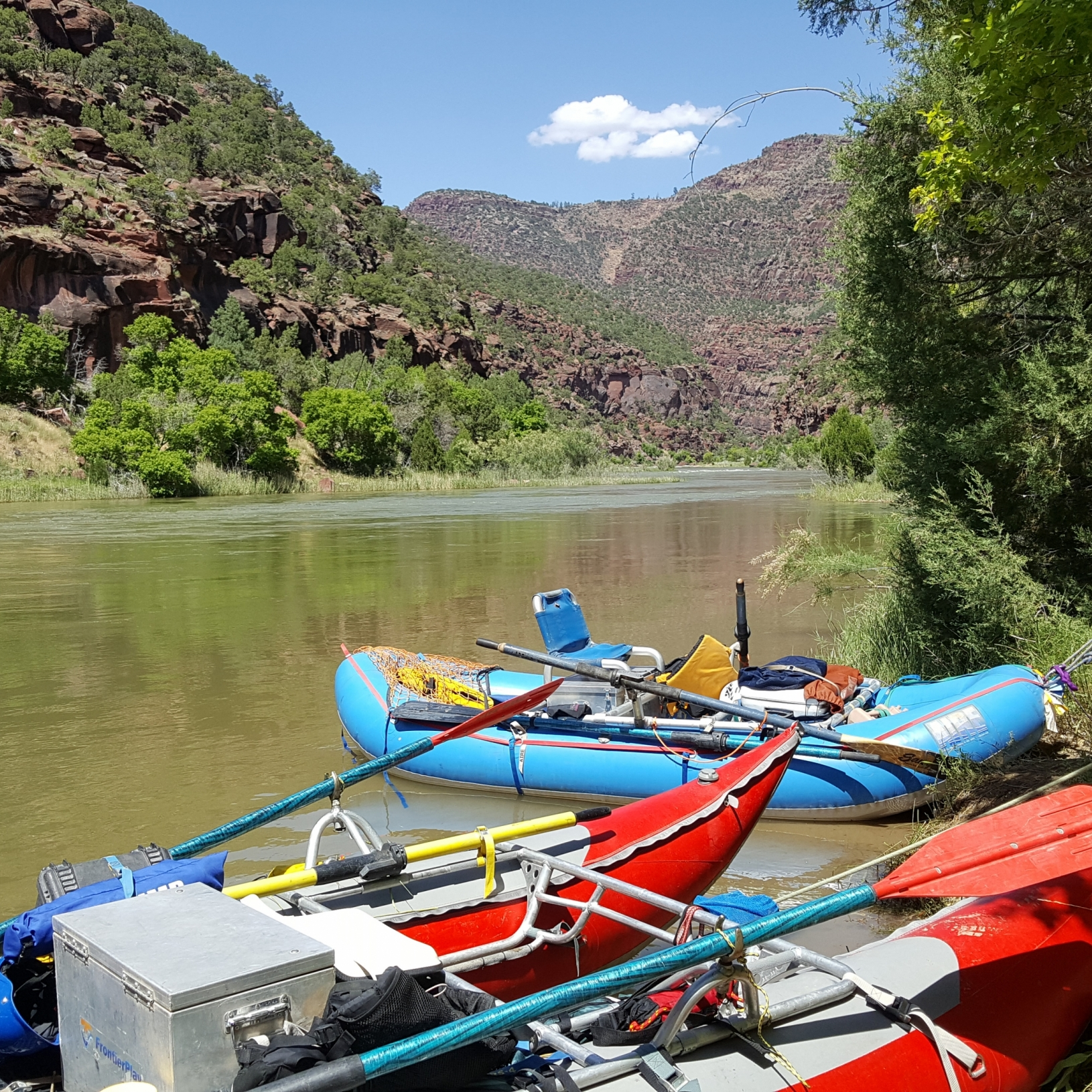 Kayaks and rafts on the river