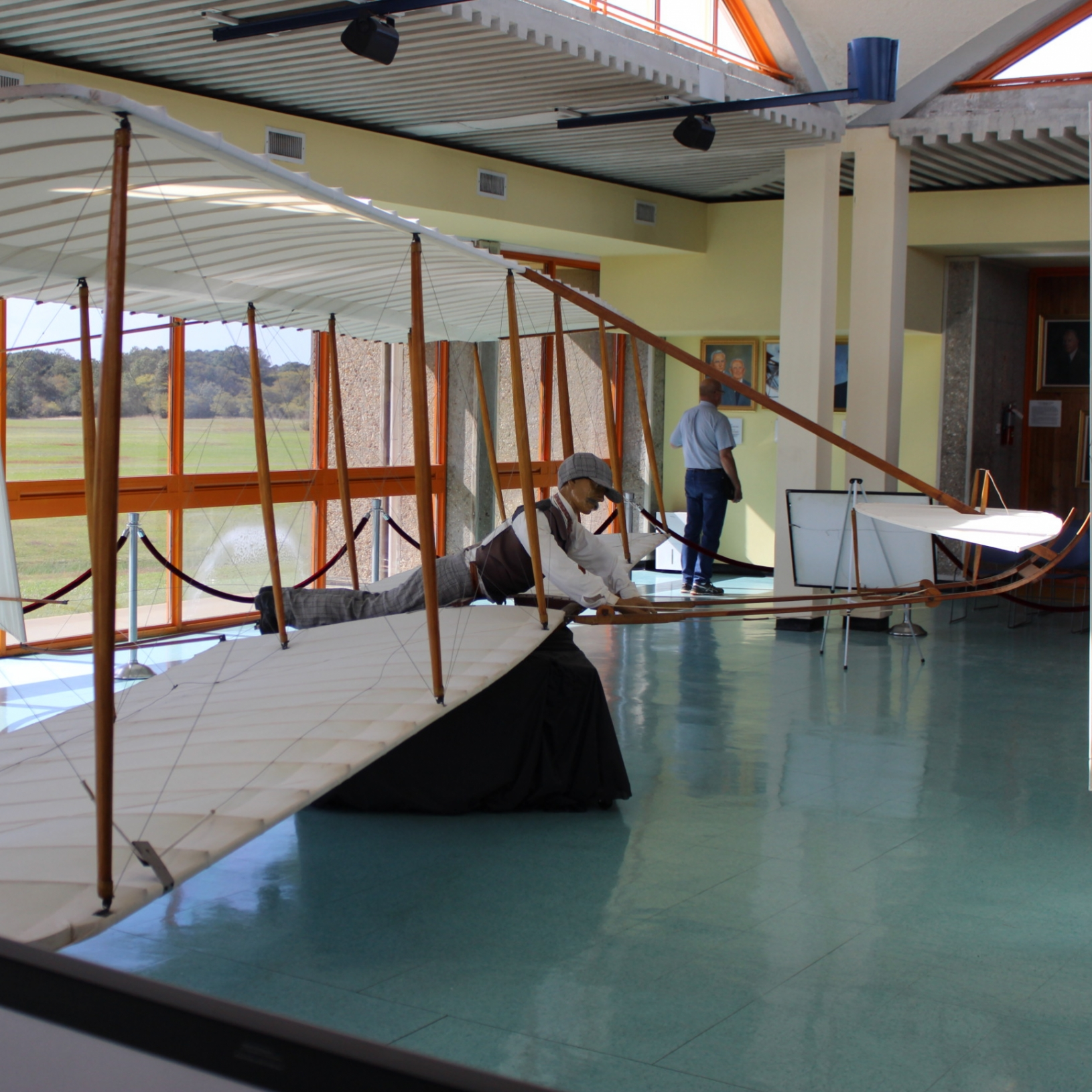 This is a full scale model of the Wright Brothers' plane, demonstrating how you would operate it.