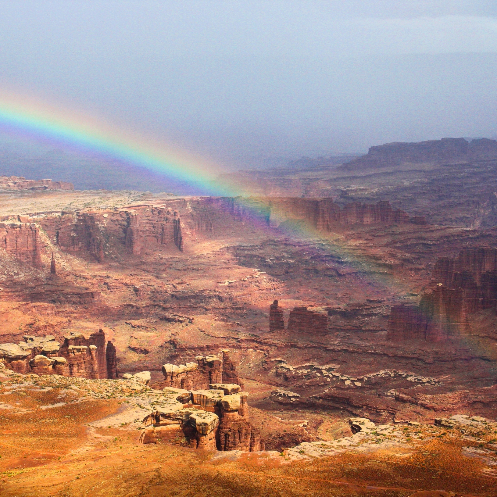Rainbow over the Grand View overlook at Canyonlands National Parks Island in the sky section.