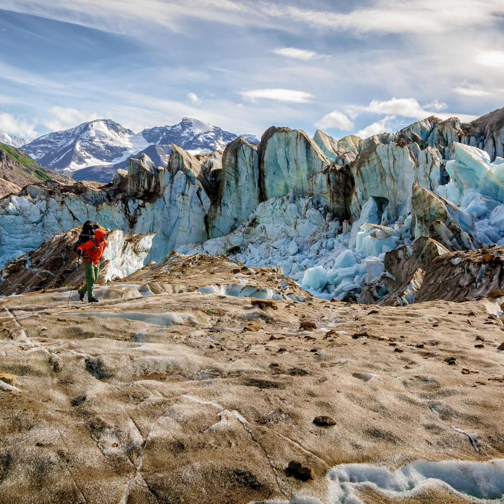 Backpacker and Ice wall on the Bremner Glacier