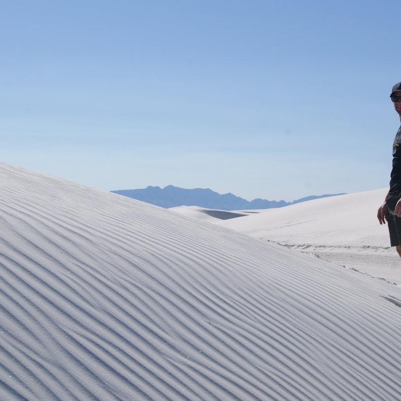 Man standing on dune at white sands national park